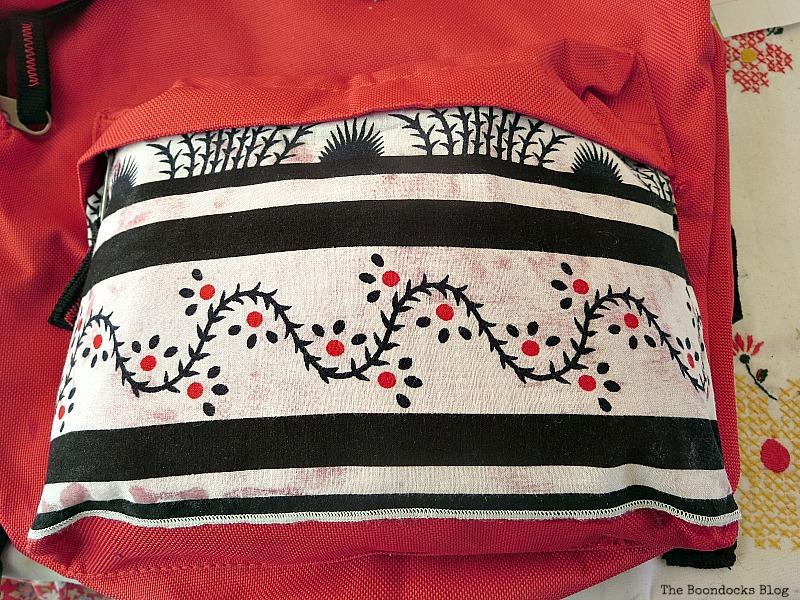 glueing fabric on the bottom pocket, School Bag Makeover, Int'l Bloggers Club Challenge www.theboondocksblog.com