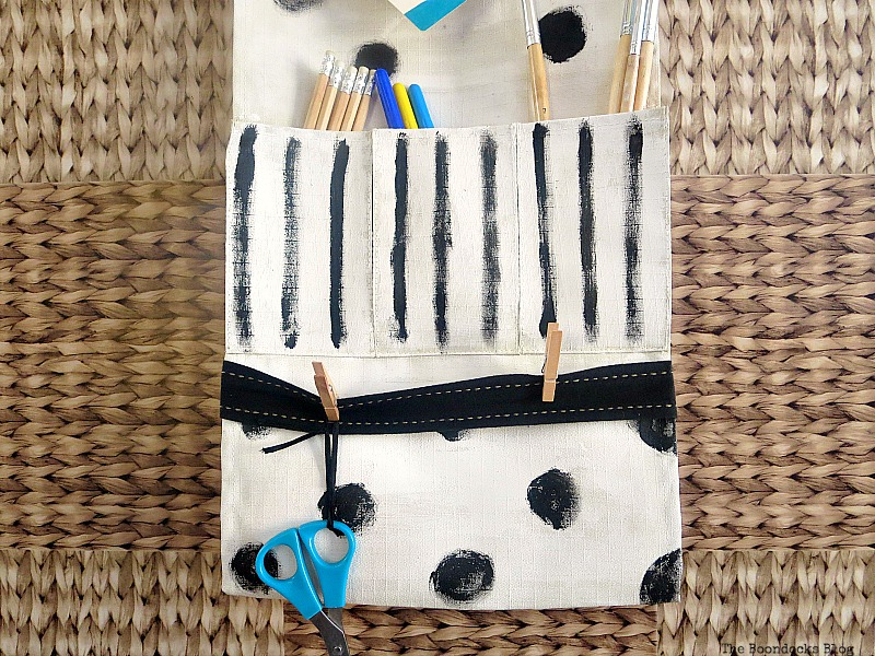 The pockets holding an assortment of pens, pencils and brushes, How to make a back to school hanging organizer, Back to School blog Hop www.theboondocksblog.com