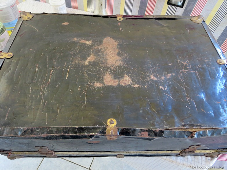 "top of a rusted vintage suitcase, used as the ""before"" image."
