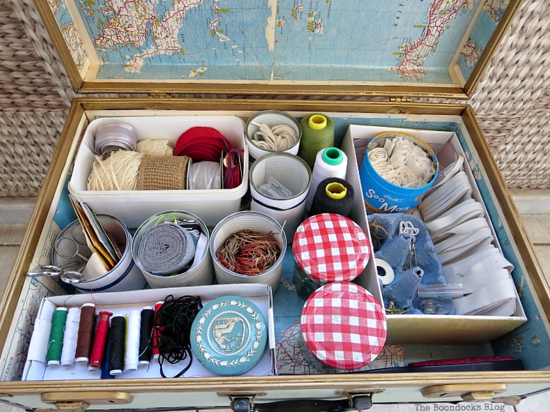 Lots of sewing supplies, What's Inside the Vintage Suitcase? www.theboondocksblog.com