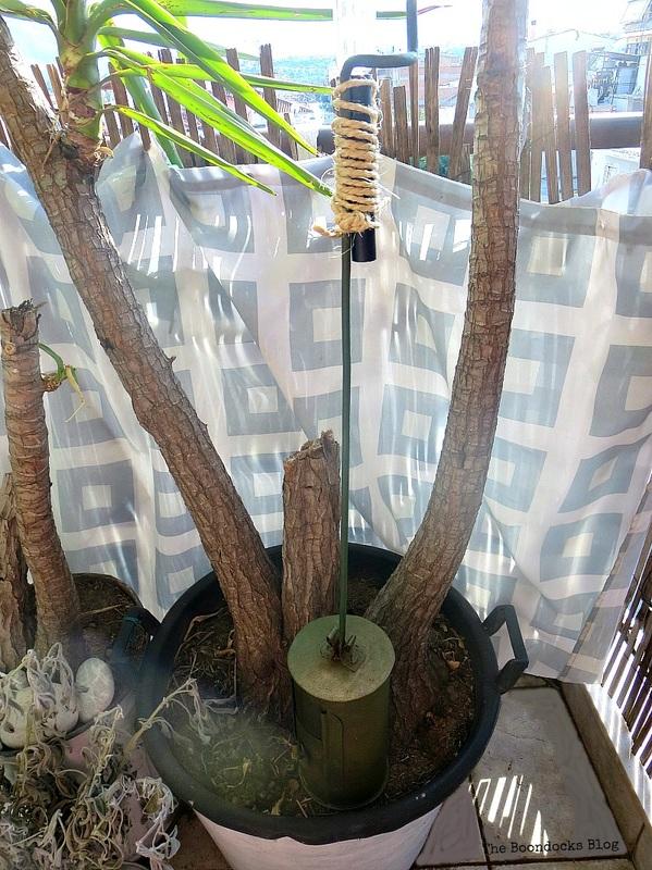in between the plant trunks, A Breen Vintage Coffee Roaster Repurpose www.theboondocksblog.com
