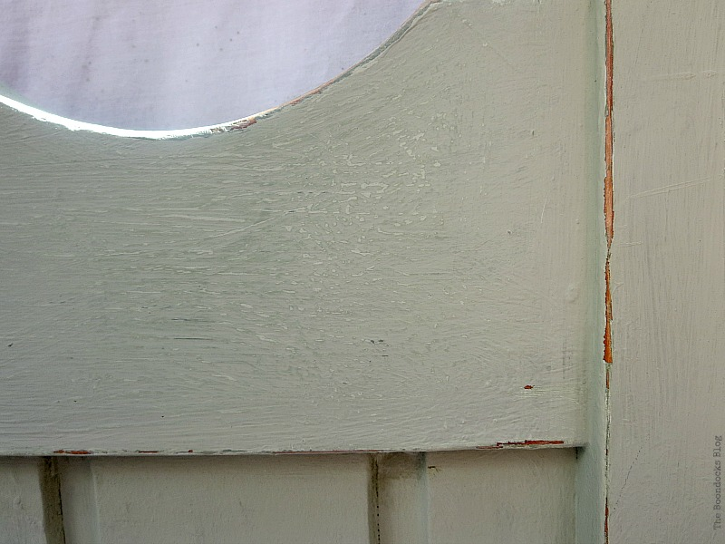 Detail of distressing, How to Makeover an Old Wooden Bed Frame www.theboondocksblog.com