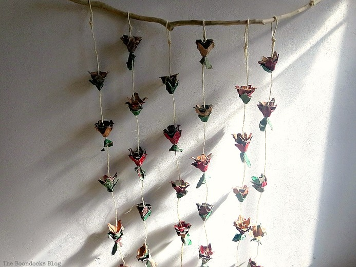 Tinished piece hanging on the wall, How to Make Easy Fall Flowers using Egg Cartons www.theboondocksblog.com