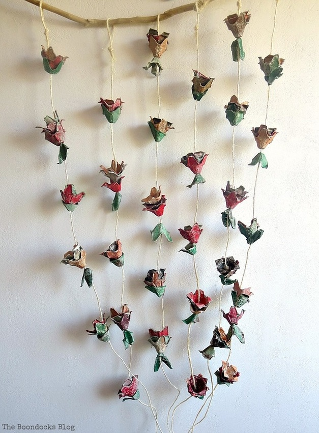 A flower wall hanging made from egg cartons, How to Make Easy Fall Flowers using Egg Cartons www.theboondocksblog.com
