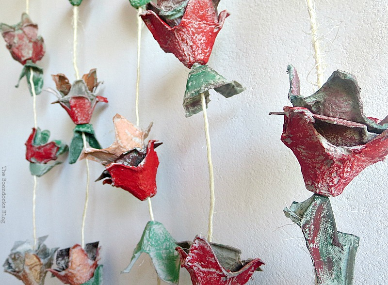 Egg shells hanging on twine, How to Make Easy Fall Flowers using Egg Cartons www.theboondocksblog.com