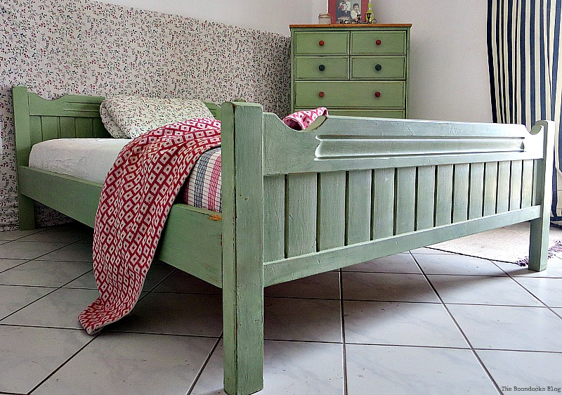 The whole bed in soft green color, How to Makeover an Old Wooden Bed Frame www.theboondocksblog.com