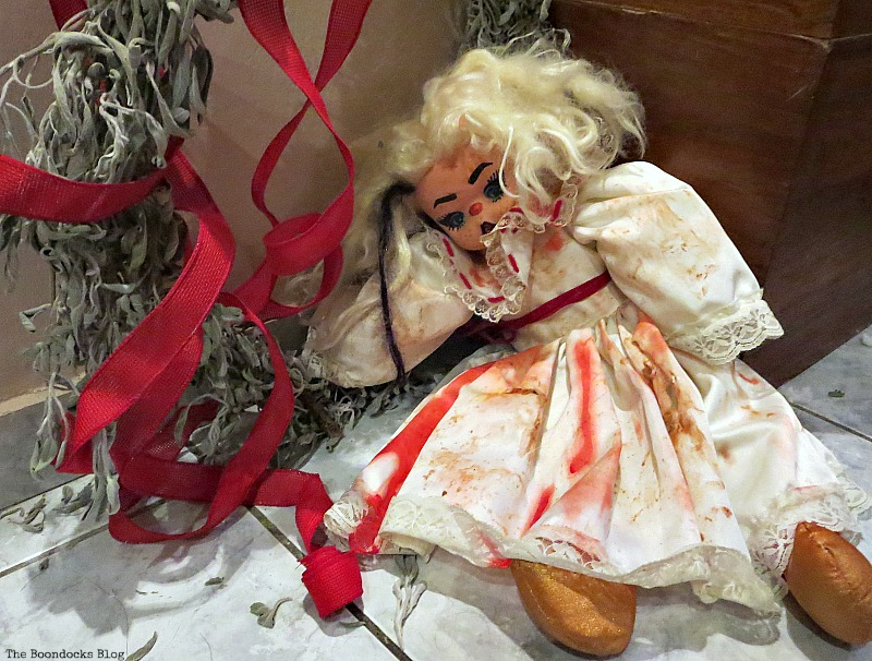 Doll eats too much and falls off her wreath. Paranoid Man goes to the Halloween Party www.theboondocksblog.com