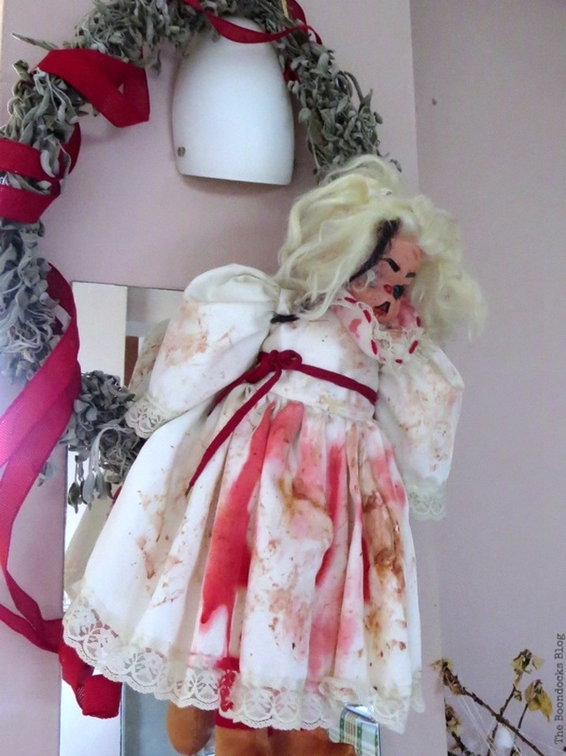 Doll hanging from wreath, Paranoid Man goes to the Halloween Party www.theboondocksblog.com