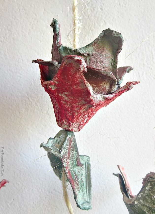 Close up image of completed red egg carton flower.