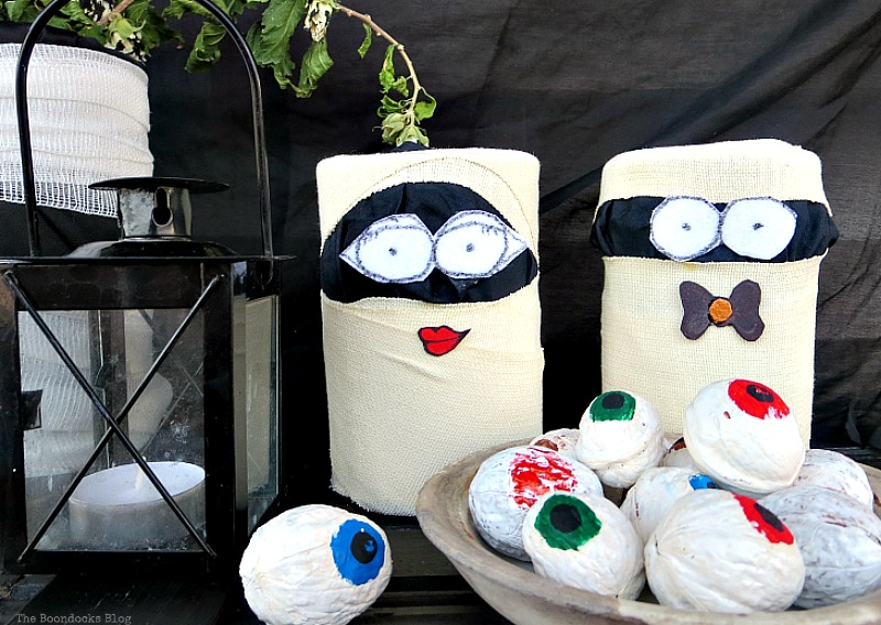 Tin mummies wrapped in black fabric and gauze, Fun and Easy Halloween Vignette - Int'l Bloggers Club Challenge www.theboondocksblog.com