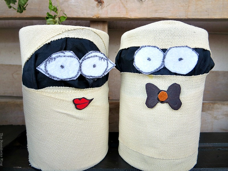 Tins wrapped in fabric and adhesive gauze with felt eyes Fun and Easy Halloween Vignette - Int'l Bloggers Club Challenge www.theboondocksblog.com