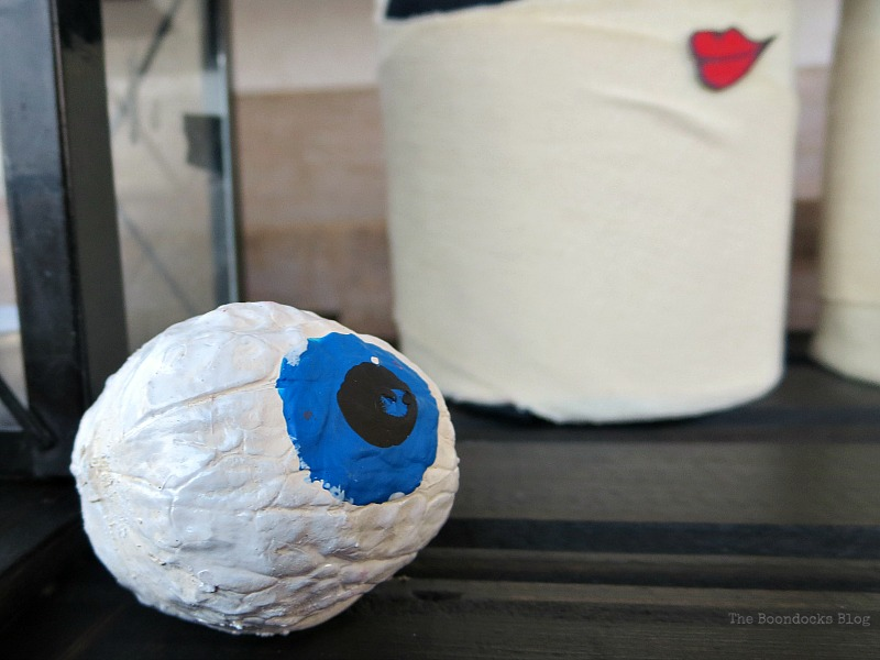 walnut painted to look like a blue eyeball, Fun and Easy Halloween Vignette - Int'l Bloggers Club Challenge www.theboondocksblog.com