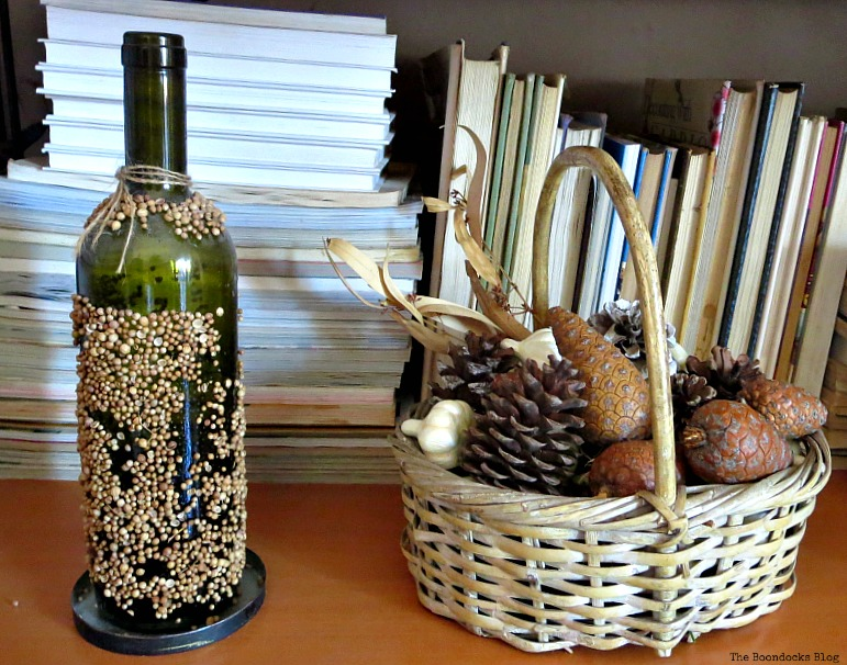 A bottle covered in seeds, Halloween Wall Unit Decor www.theboondocksblog.com
