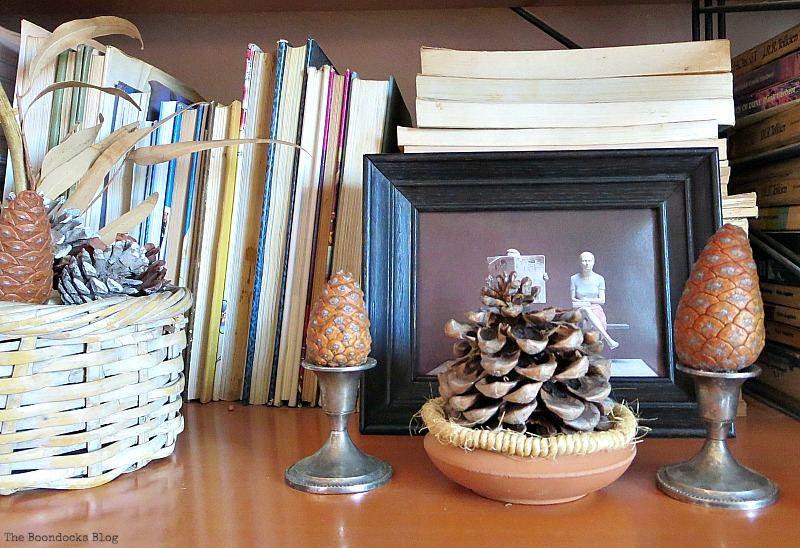 Black framed image and pinecones, Halloween Wall Unit Decor www.theboondocksblog.com