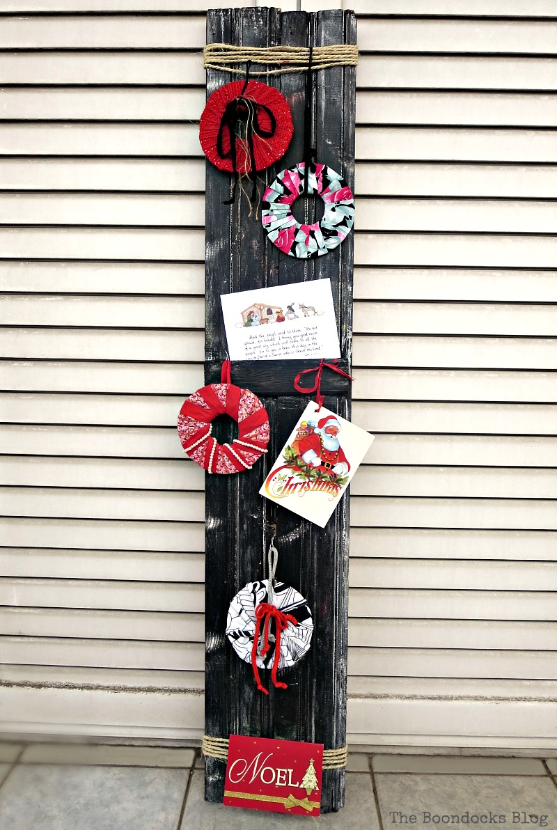 A wooden board used as display. A Display for Christmas Cards and Ornaments www.theboondocksblog.com