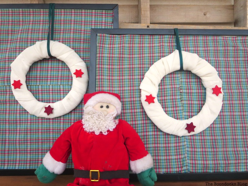 Finished wreaths and frames with Santa, Christmas Picture Frames with Wreaths the Lazy Way www.theboondocksblog.com