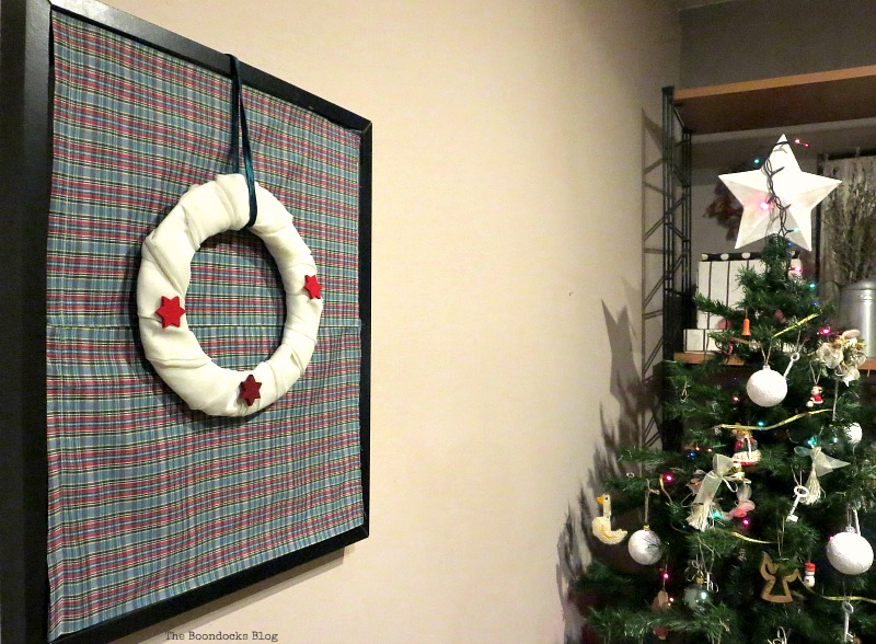 Next to the tree, Christmas Picture Frames with Wreaths the Lazy Way www.theboondocksblog.com