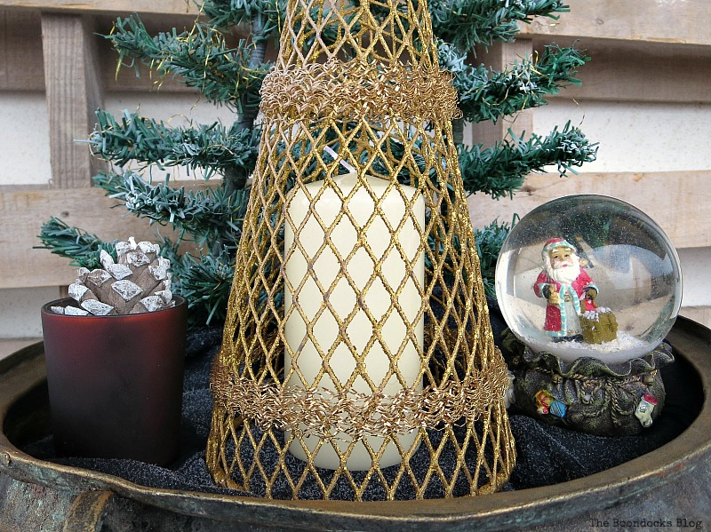 a white candle is placed under the gold tree, A repurposed Antique Cauldron for Christmas theboondocksblog