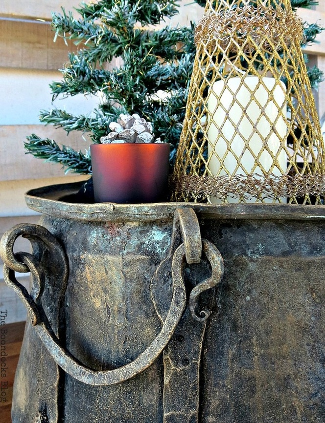 Detail of antique cauldron with red votive, A repurposed Antique Cauldron for Christmas theboondocksblog