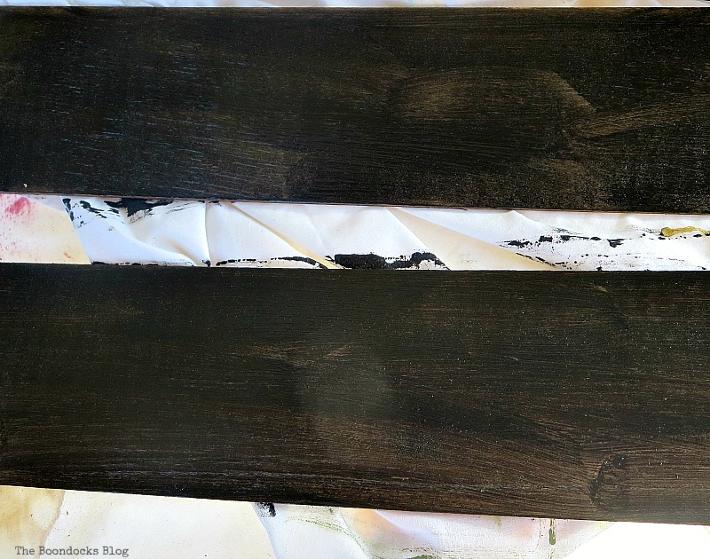 Painting the wood with chalkboard paint, Easy Chalkboard signs for the Holidays www.theboondocksblog.com