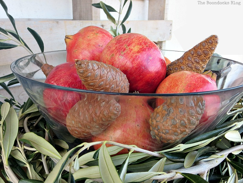 Pomegranetes and pinecones inside bowl placed with in olive branch circle, Natural Thanksgiving Centerpieces, Thankful at Home www.theboondocksblog.com