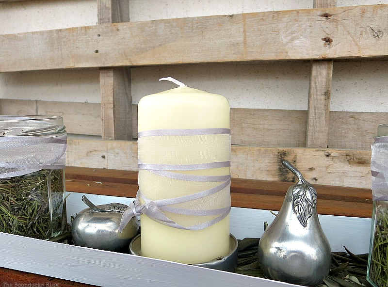The candle wrapped in grey ribbon, Easy Green Christmas Centerpieces www.theboondocksblog.com