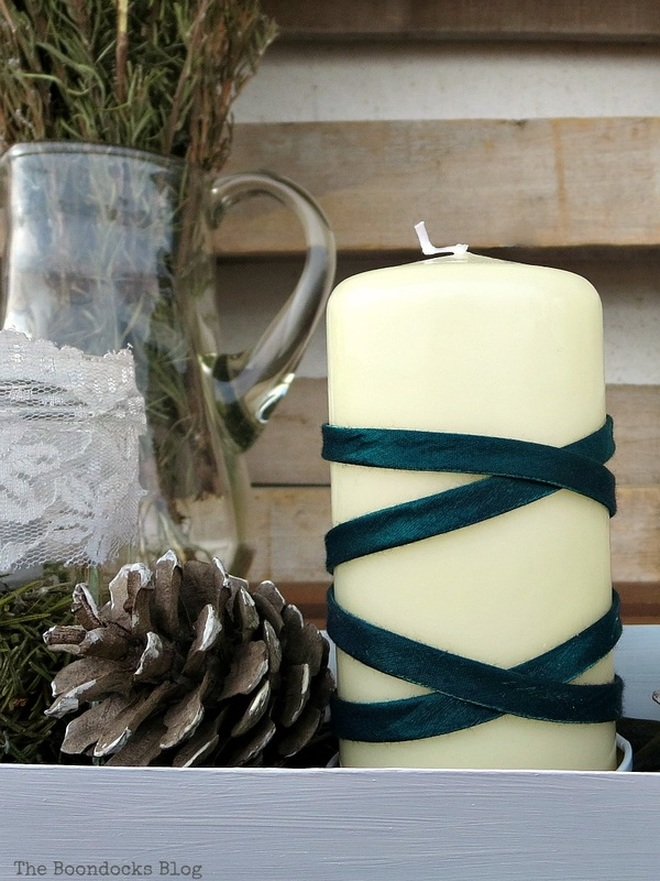 Candle wrapped in green ribbon for a Christmas centerpiece, Easy Green Christmas Centerpieces www.theboondocksblog.com
