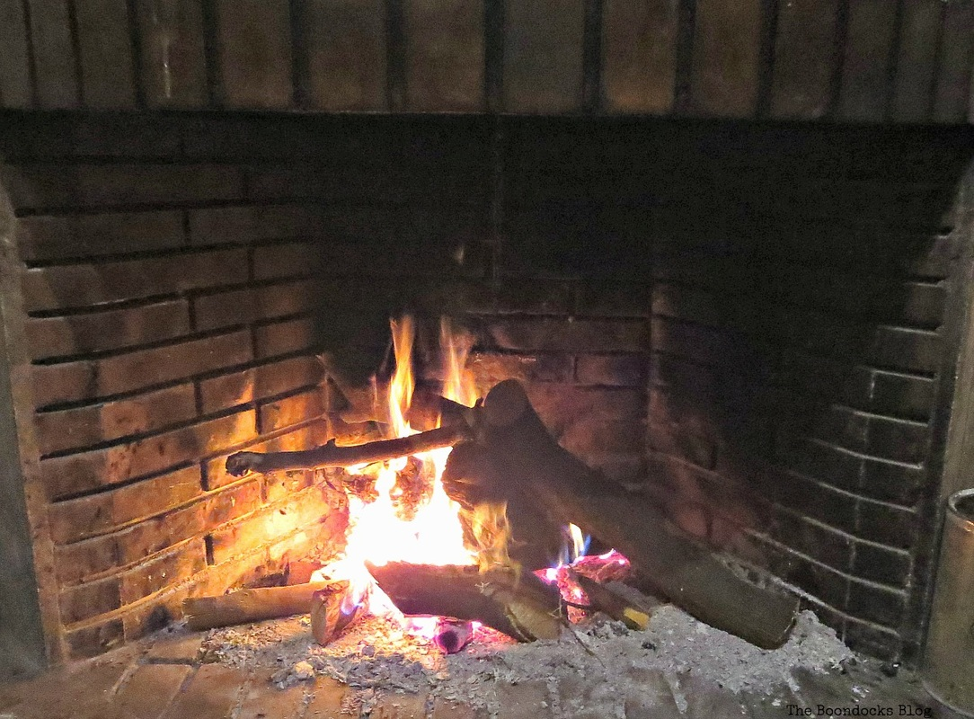 A lit fire in the fireplace, Facebook Photos for November www.theboondocksblog.com