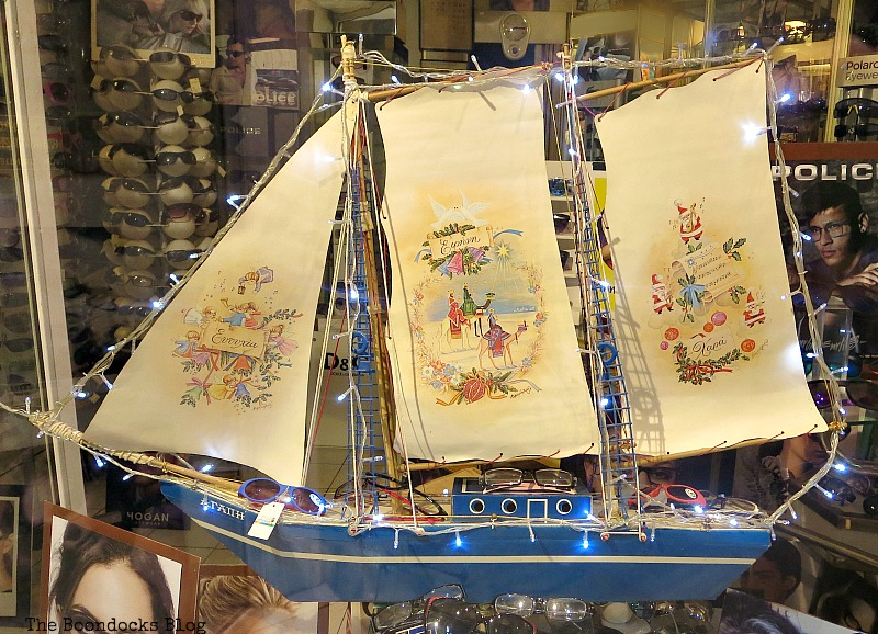 A sailboat in a store window, Christmas Traditions in Greece, Int'l Bloggers Club www.theboondocksblog.com