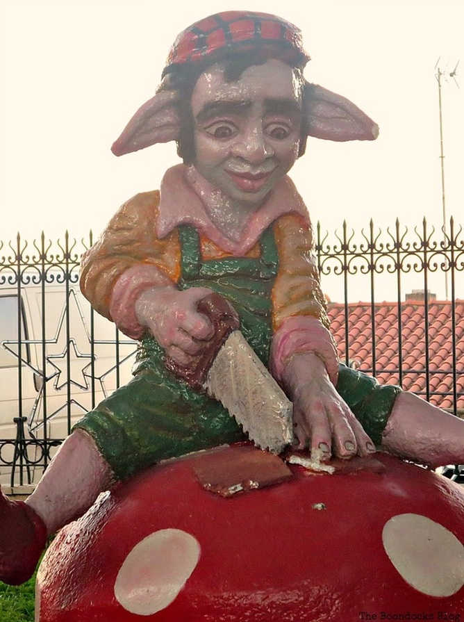 A goblin sawing a piece of wood, Christmas Traditions in Greece, Int'l Bloggers Club www.theboondocksblog.com