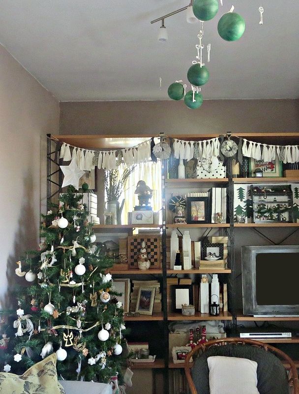 lomg view of living room and wall unit, How to Repurpose your Decor for a Unique Christmas Look www.theboondocksblog.com