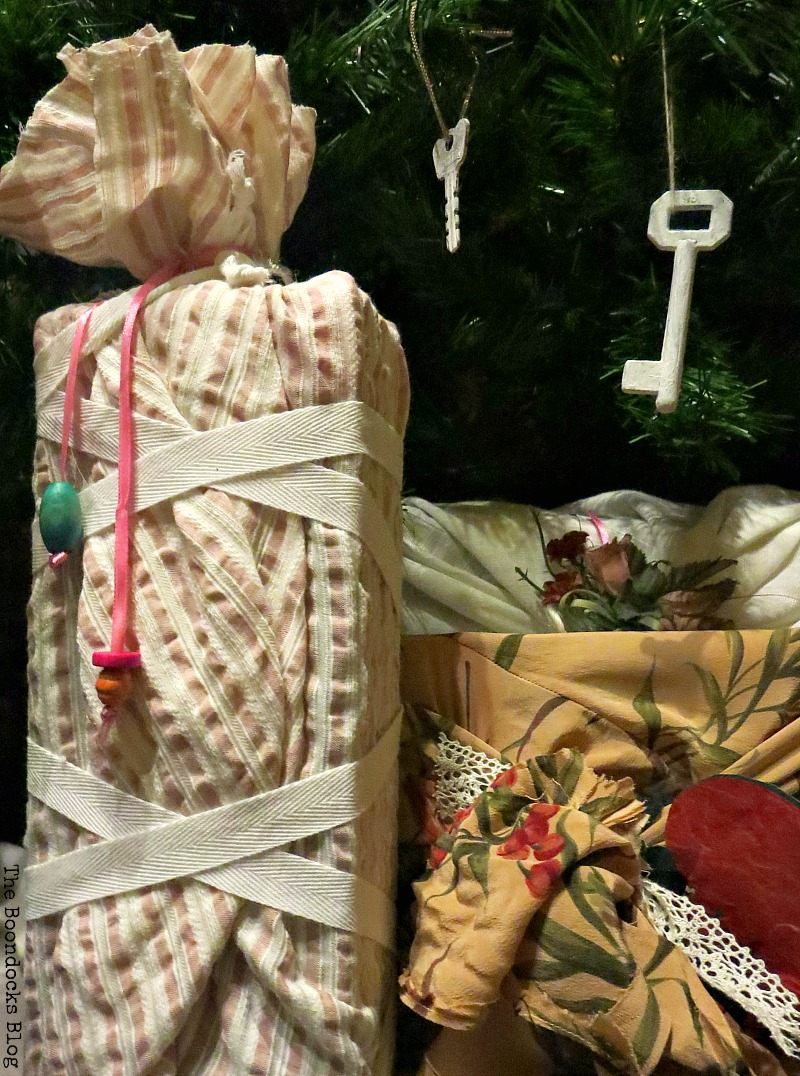 Adding beads and white ribbon to a wrapping, How to Repurpose vintage fabric for gift wrapping, the boondocksblog.com