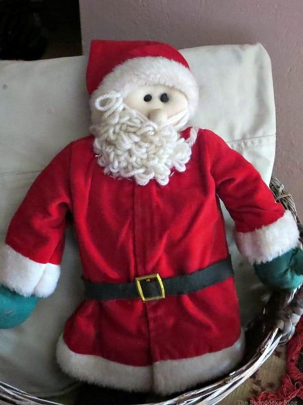 Stuffed Santa in basket, A Repurposed Spice Rack vignette for Christmas, www.theboondocksblog.com