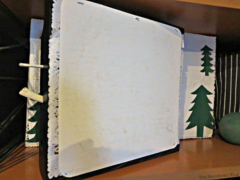 Adding cardboard on the back of the spice rack, A Repurposed Spice Rack vignette for Christmas, www.theboondocksblog.com