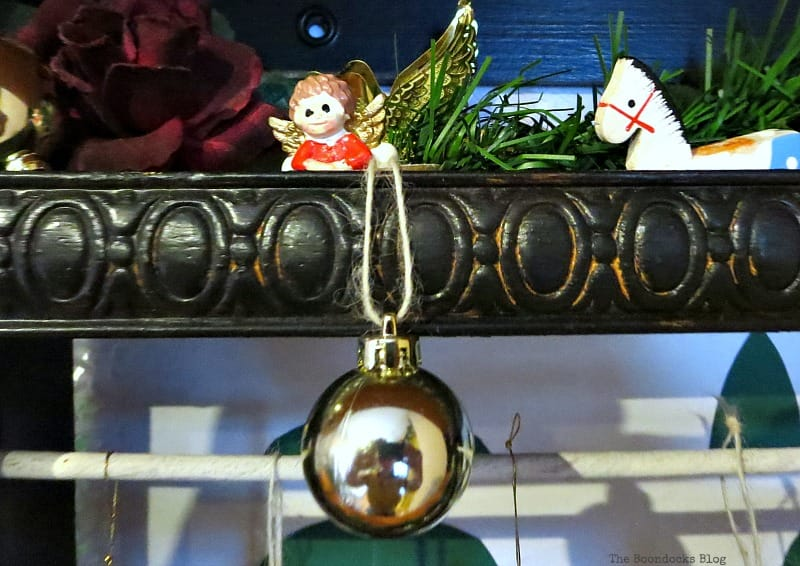 Adding the ornaments, A Repurposed Spice Rack vignette for Christmas, www.theboondocksblog.com