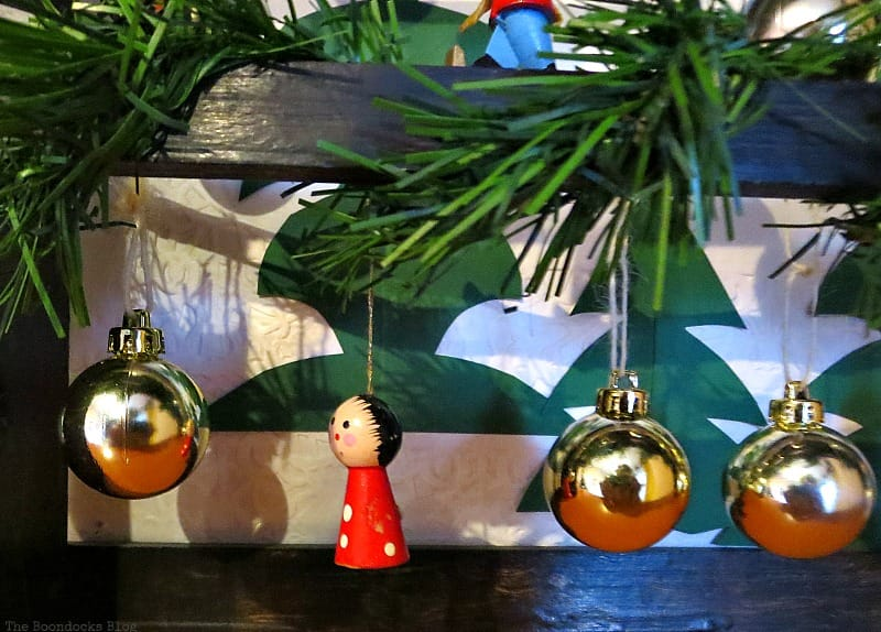 Hanging ornaments and globes, A Repurposed Spice Rack vignette for Christmas, www.theboondocksblog.com