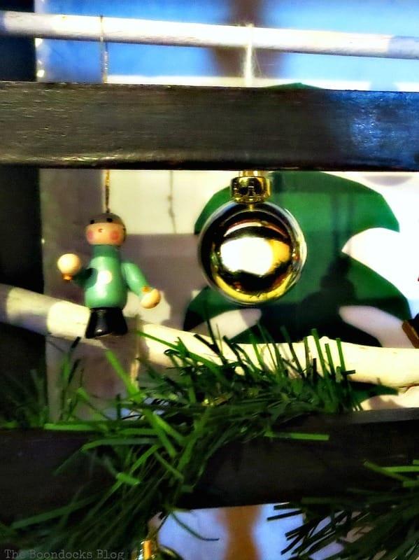 Closeup of gold globe, A Repurposed Spice Rack vignette for Christmas, www.theboondocksblog.com