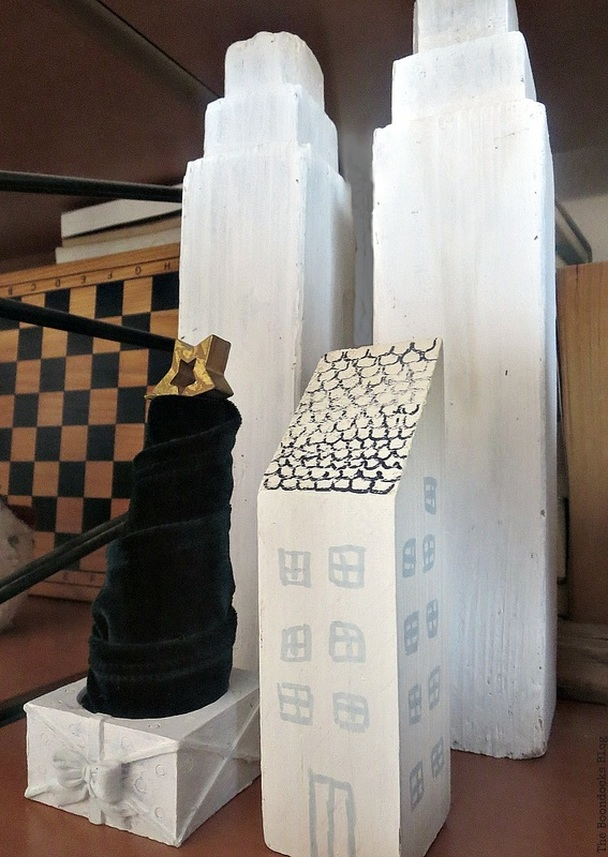Wooden legs and piece repurposed as buildings, velvet Christmas tree, How to Repurpose your Decor for a Unique Christmas Look www.theboondocksblog.com
