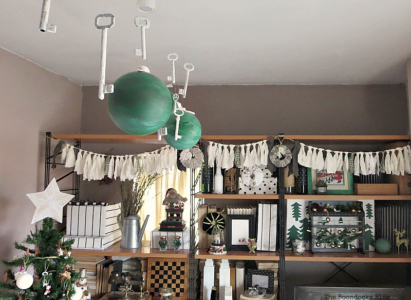 Ceiling with lights and globes, How to Repurpose your Decor for a Unique Christmas Look www.theboondocksblog.com