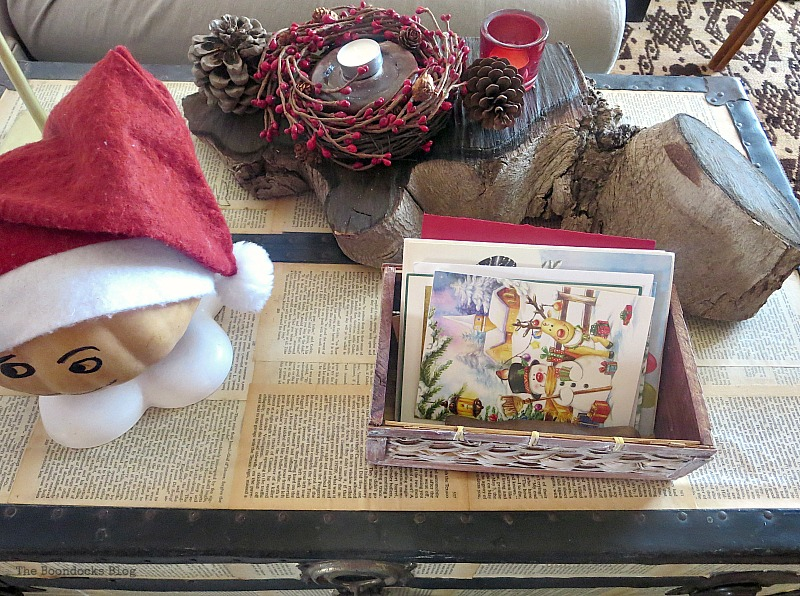 Decoupaged trunk with wooden centerpiece, How to Repurpose your Decor for a Unique Christmas Look www.theboondocksblog.com