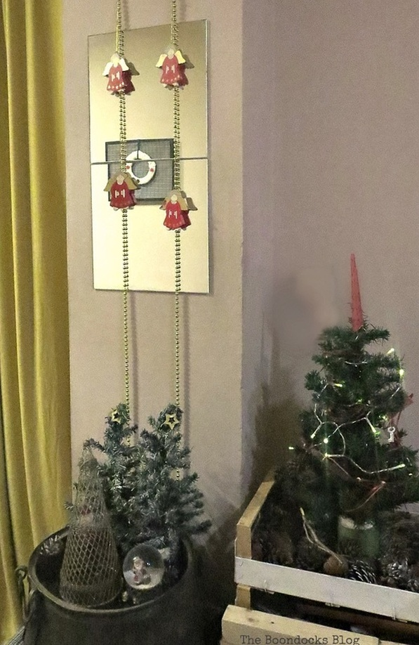 gold garland hung with wooden angels, How to Repurpose your Decor for a Unique Christmas Look www.theboondocksblog.com