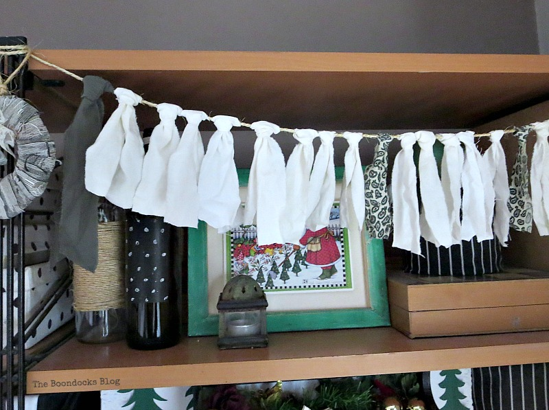 Green canvas with Christmas Card, How to Repurpose your Decor for a Unique Christmas Look www.theboondocksblog.com