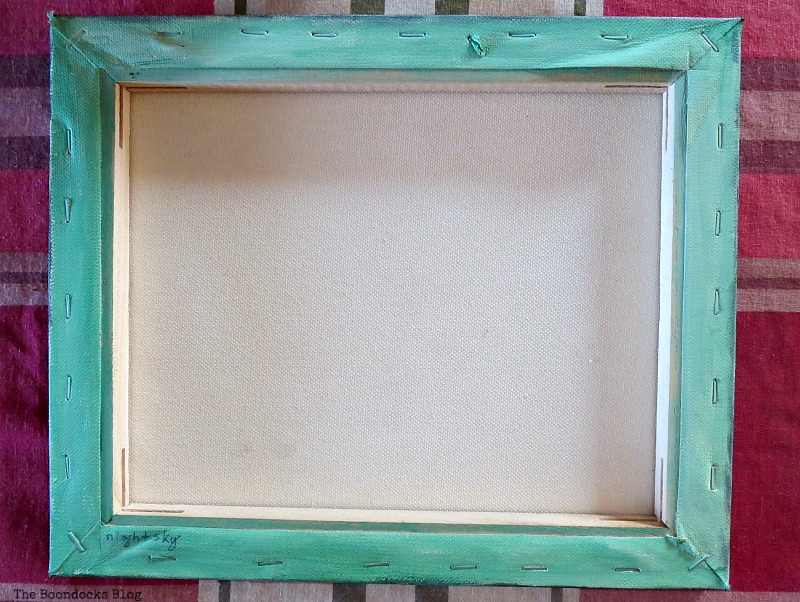 Canvas turned over and painted green, How to Repurpose your Decor for a Unique Christmas Look www.theboondocksblog.com