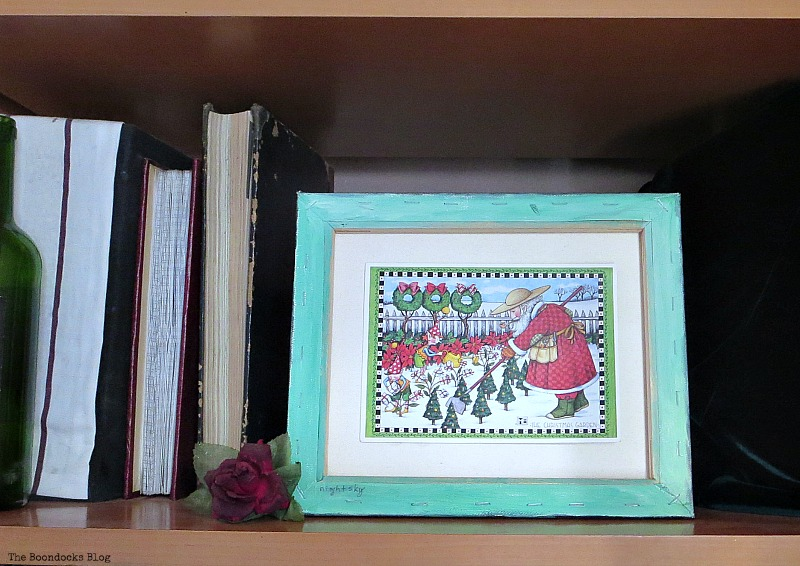 Green canvas frame with Christmas Card, How to Repurpose your Decor for a Unique Christmas Look www.theboondocksblog.com