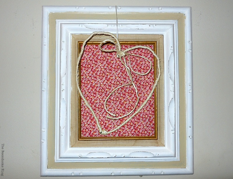 adding a white ribbon to hang the heart, Valentine's Day Framed Heart Craft - Int'l Bloggers Club www.theboondocksblog.com