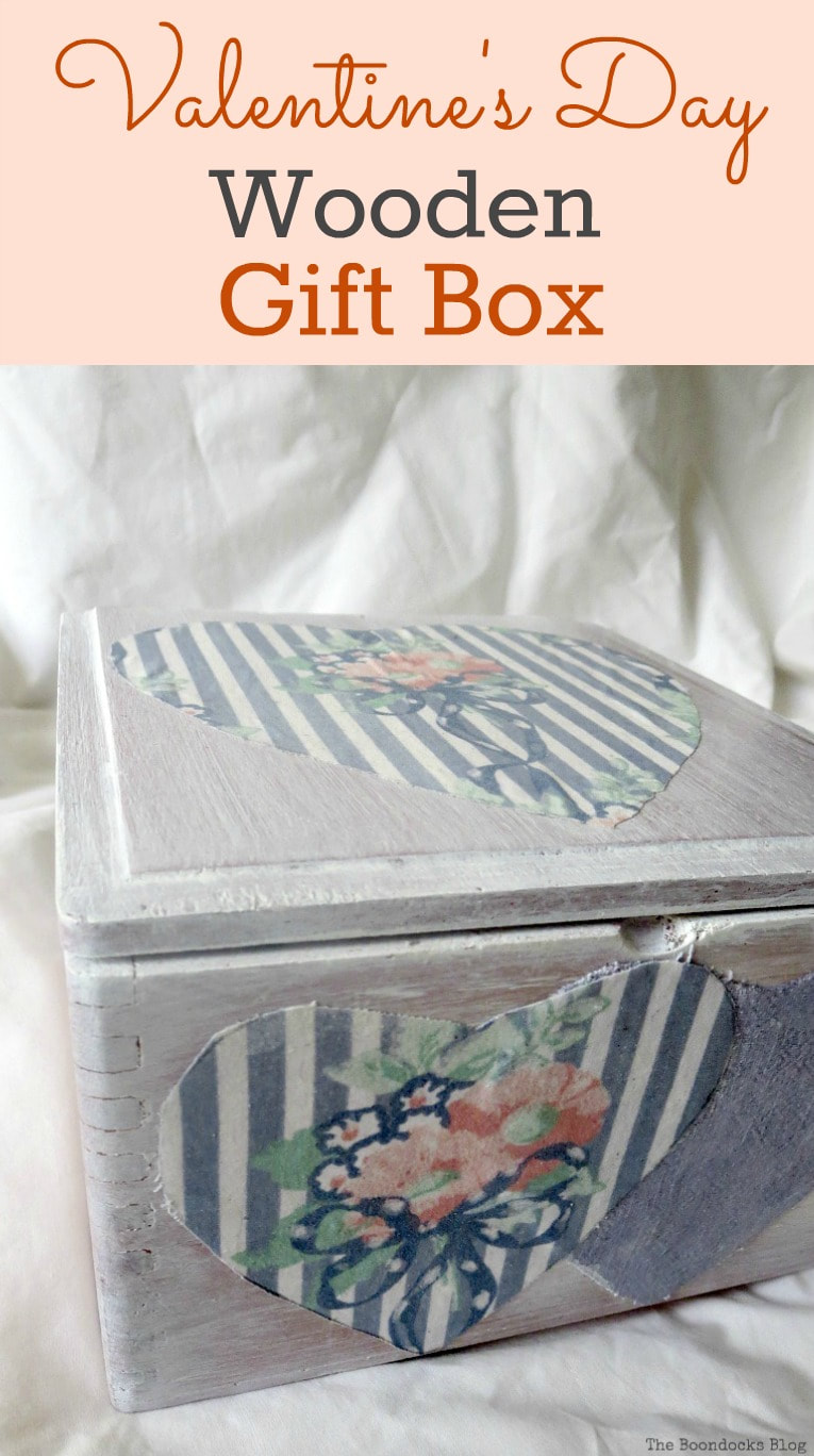 An old cigar box, white washed and decoupaged into a gift box, Valentine's Day Wooden Gift Box www.theboondocksblog.com #repurpose #Upcycle #ValentinesDay #Heartshaped #Decooupage #whitewashedbox #giftbox