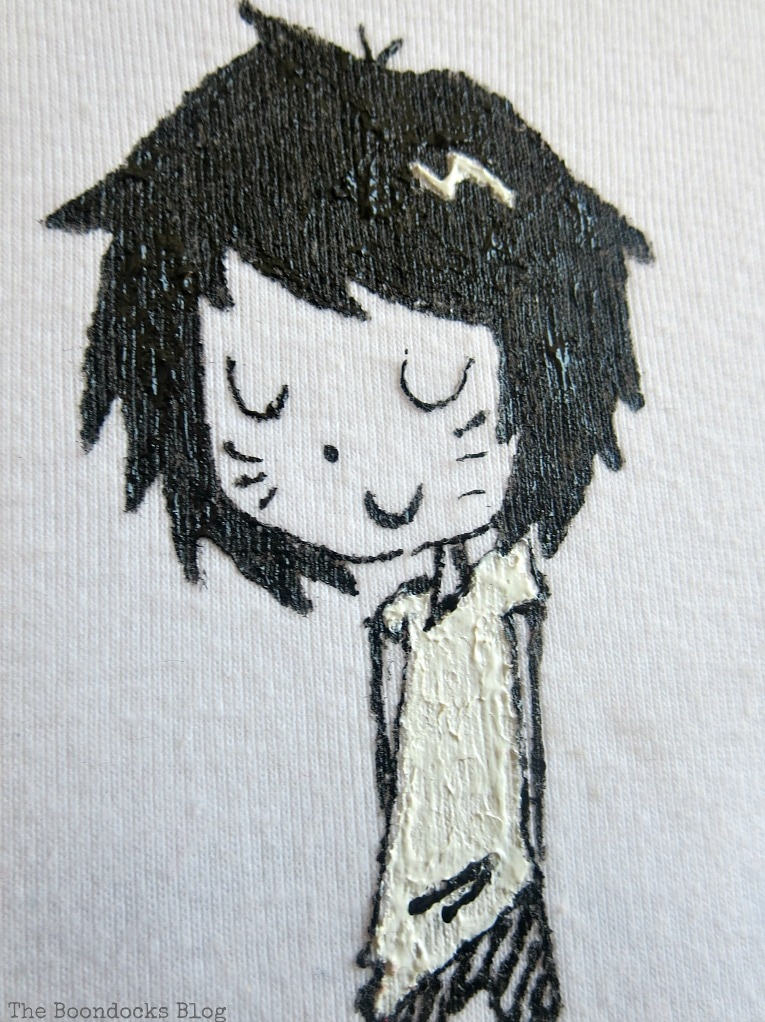 close up of drawing on t-shirt, An Easy Repurpose of a T-Shirt into Wall Art, www.theboondocksblog.com