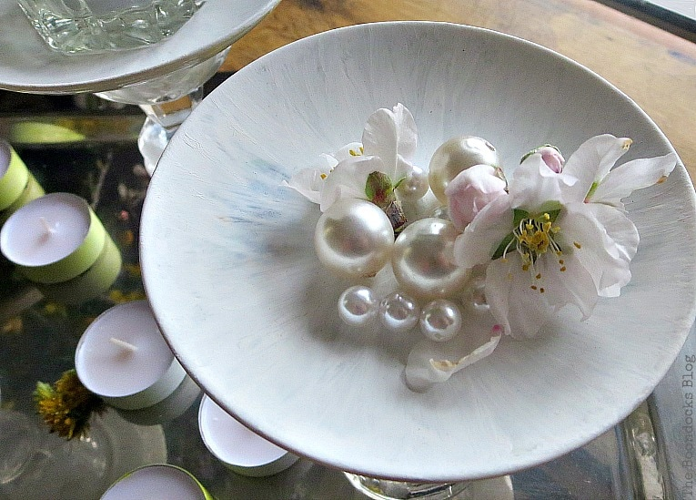 flower and faux pearls placed on saucer, Repurposed Cordial Glasses and Saucers for a Spring Craft Pedestal, www.theboondocksblog.com