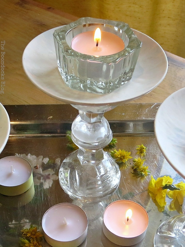 lighting the tealight, Repurposed Cordial Glasses and Saucers for a Spring Craft Pedestal, www.theboondocksblog.com