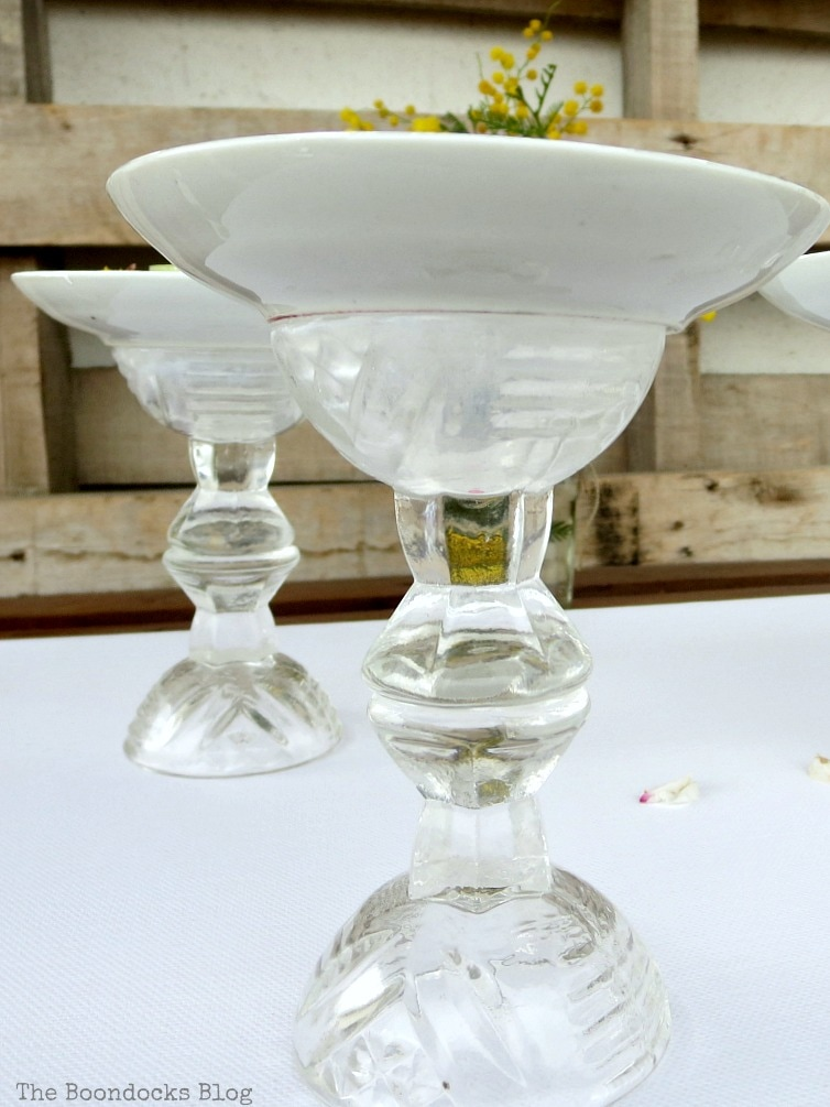 Close up of the cordial glasses and saucer made into a pedestal.